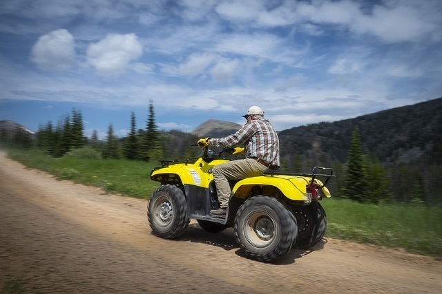 Elderly man driving ATV